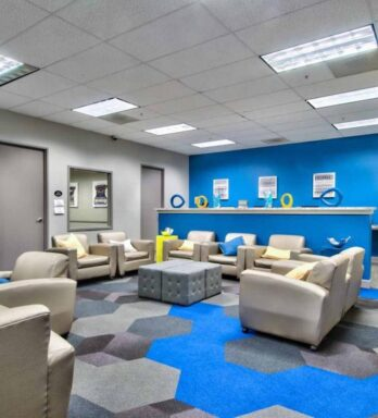 Business Center/learning space for students with computer printer, private study spaces and open seating space.